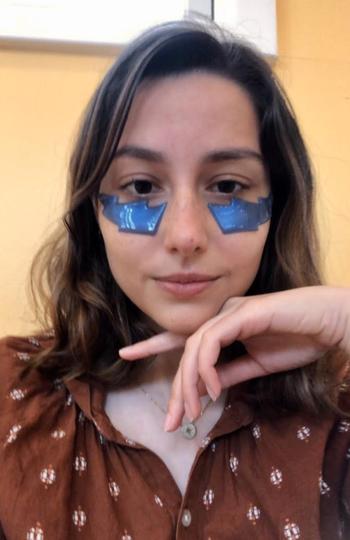 BuzzFeed Editor Genevieve Scarano wearing the eye masks