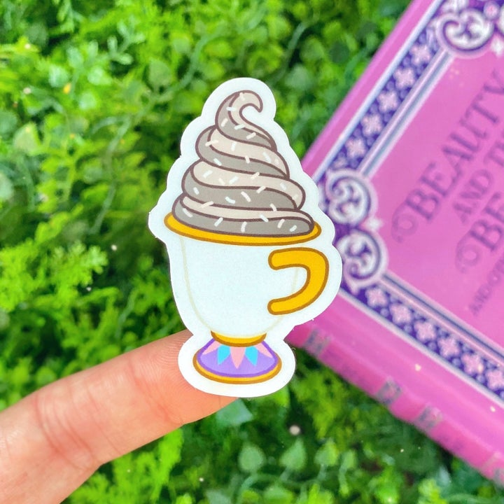 A sticker of Chip the teacup with gray ice cream