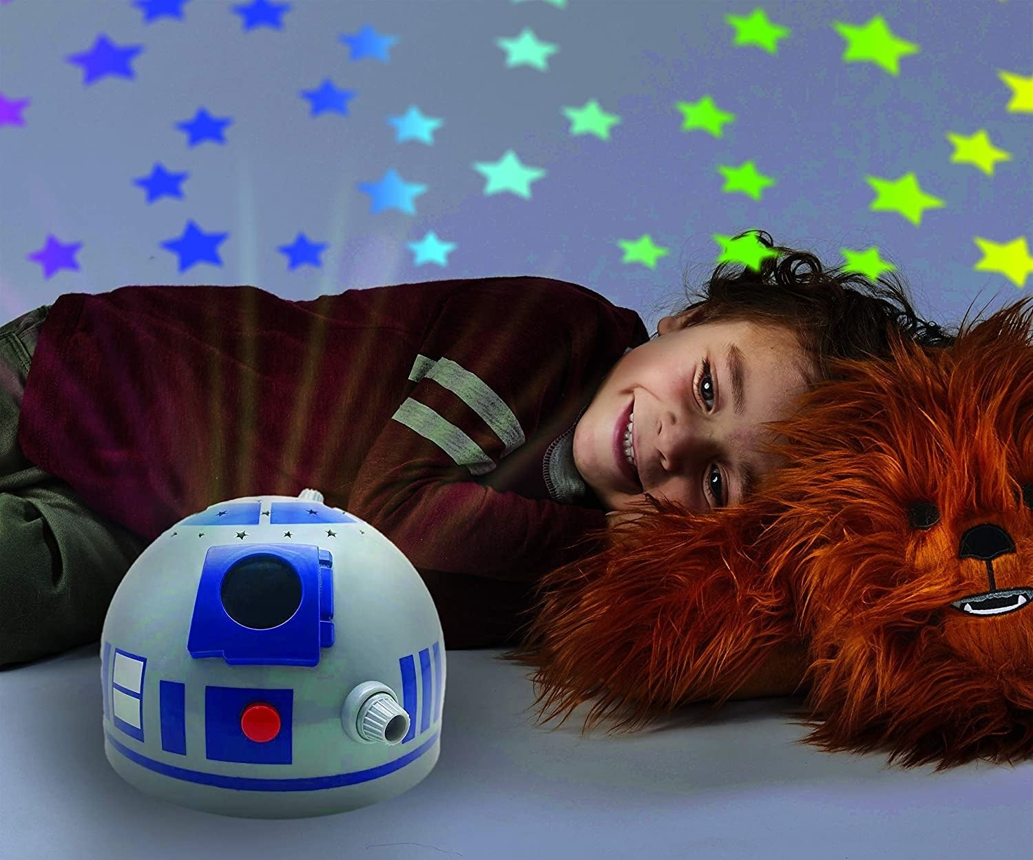 Child model with R2D2 light up pillow