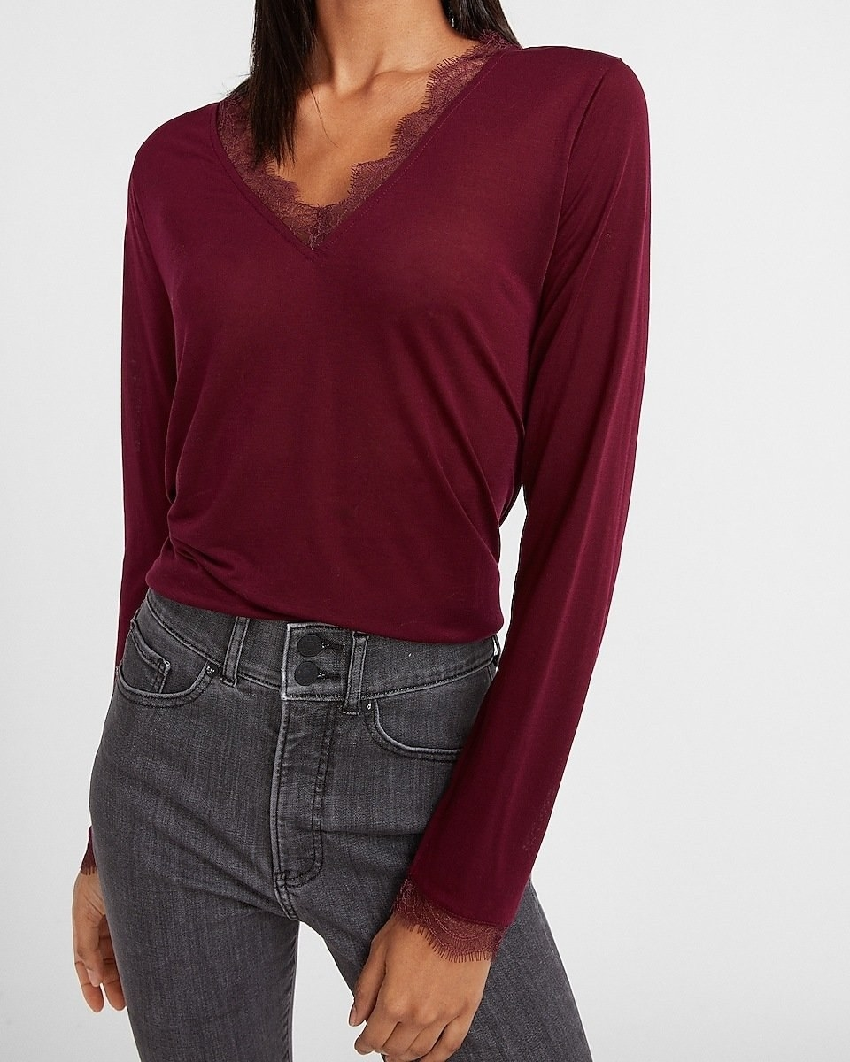 long sleeve shirt with lace embellishments on sleeves and neckline