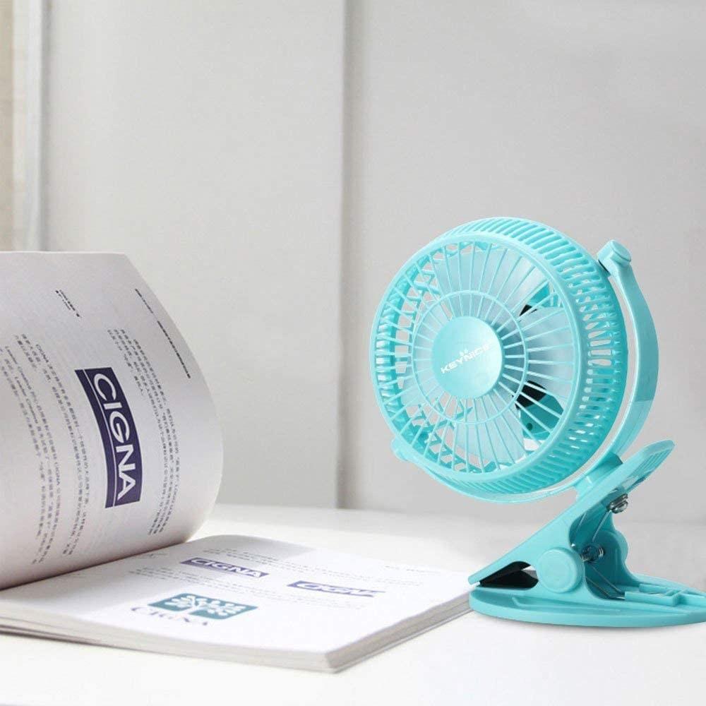 A small, blue desk fan