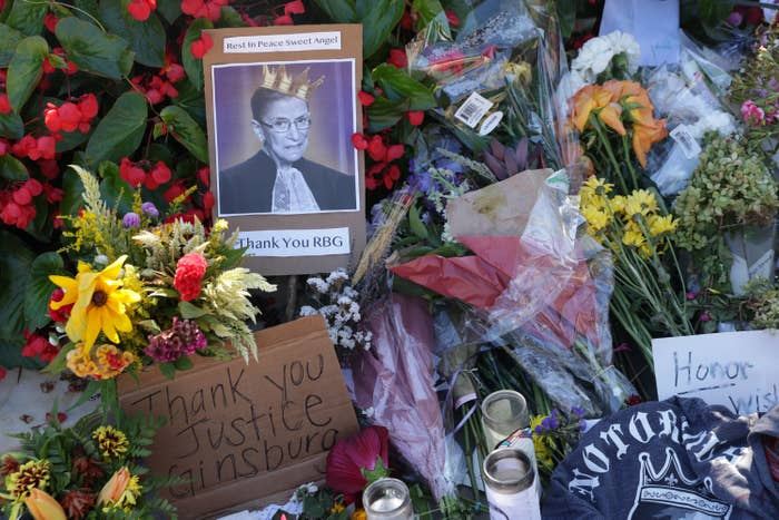 Makeshift memorial to Ruth Bader Ginsburg filled with flowers, candles, and cards