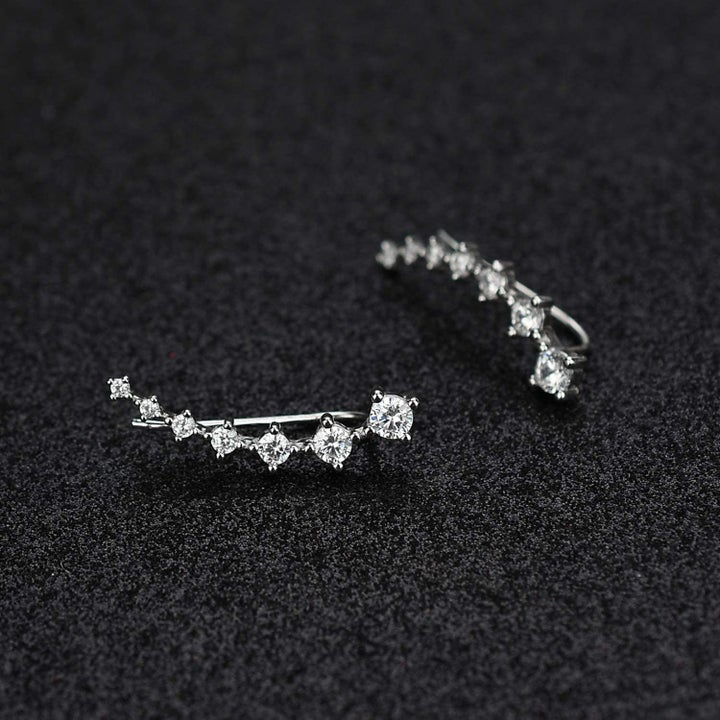 The crystal cuff earrings.