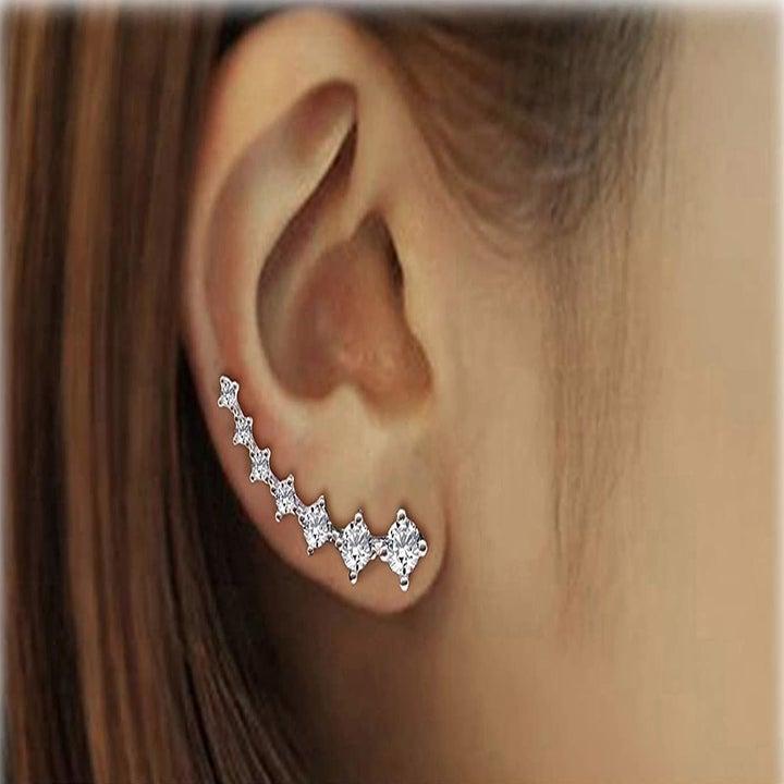 The earrings on someone's ears.