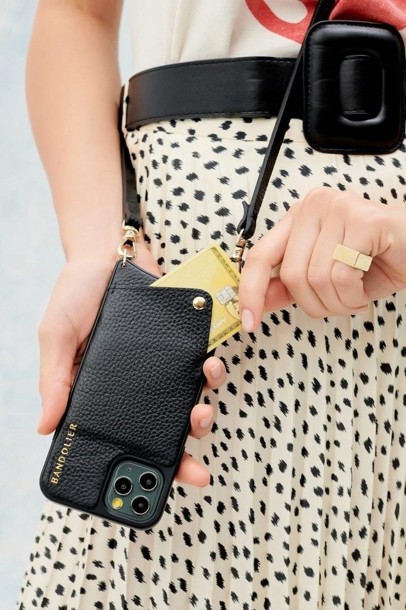 A model wears the emma pebble leather wearable phone case