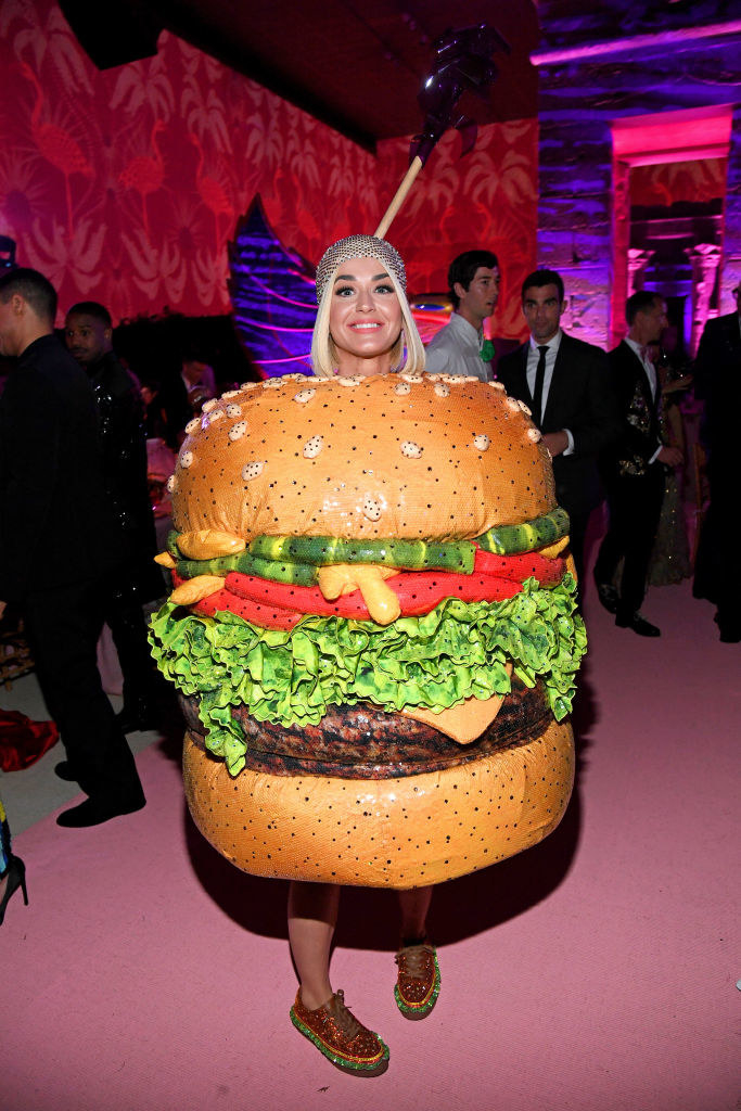 Katy Perry's cocktail slider costume featured patties, cheese, lettuce, tomatoes, pickles, and matching shoes