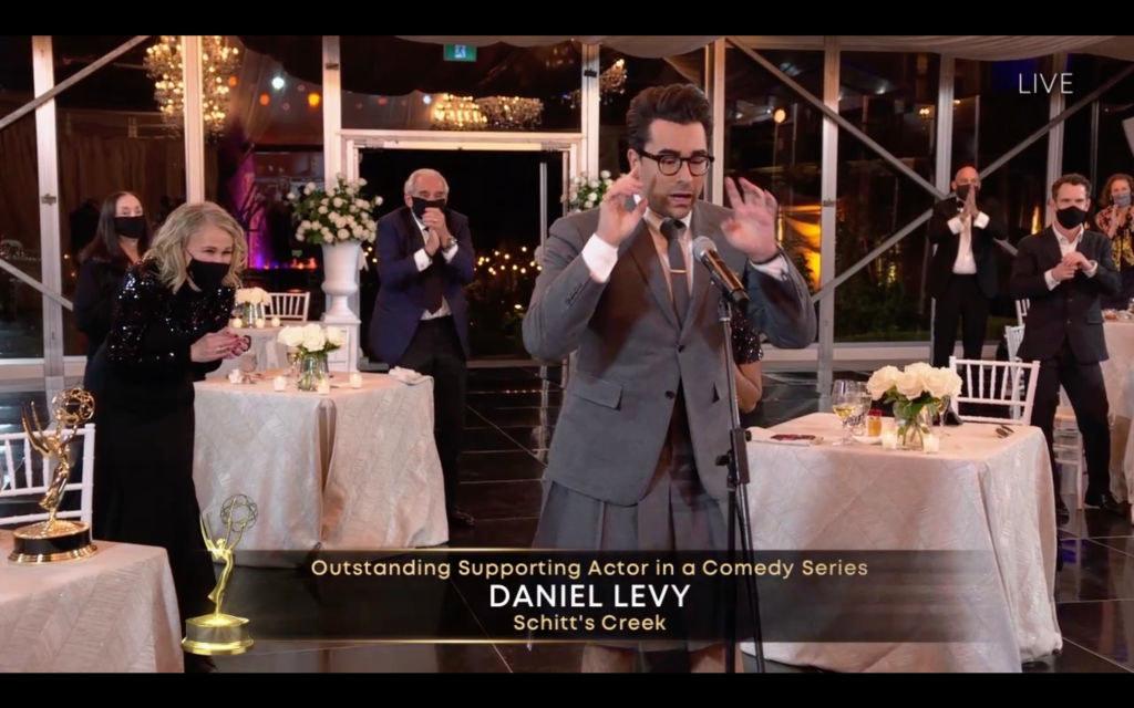 Daniel Levy giving an acceptance speech