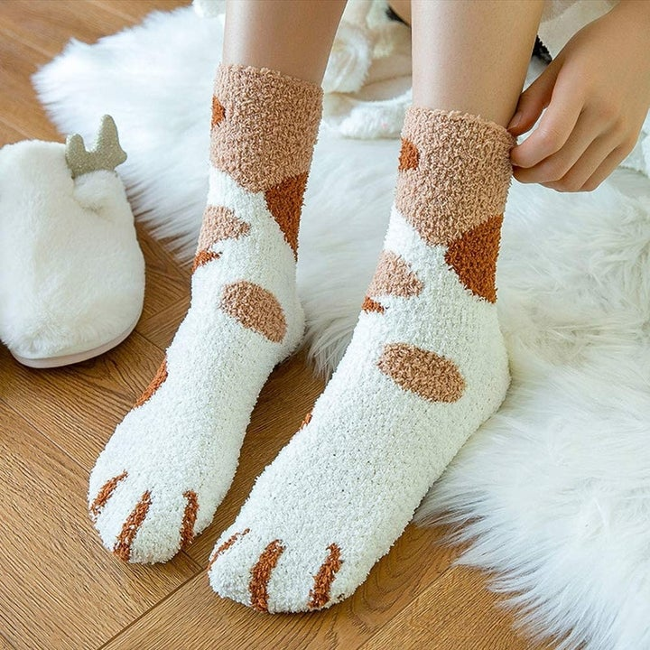 Top of socks with spots and paws