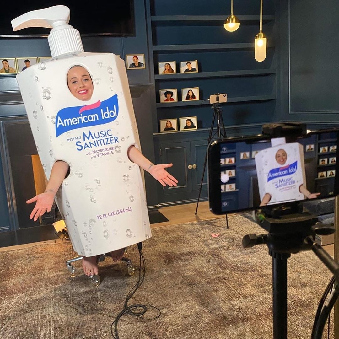 Katy Perry in her costume with words, American Idol Instant Music Sanitizer being filmed on a phone