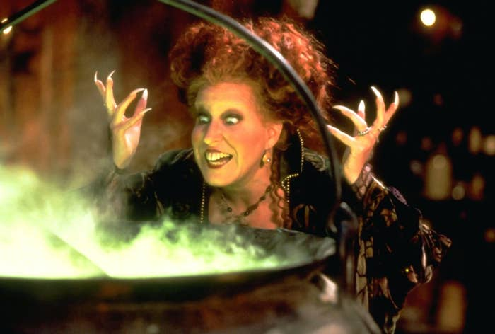 Bette Midler as Winnifred standing in front of her cauldron in Hocus Pocus