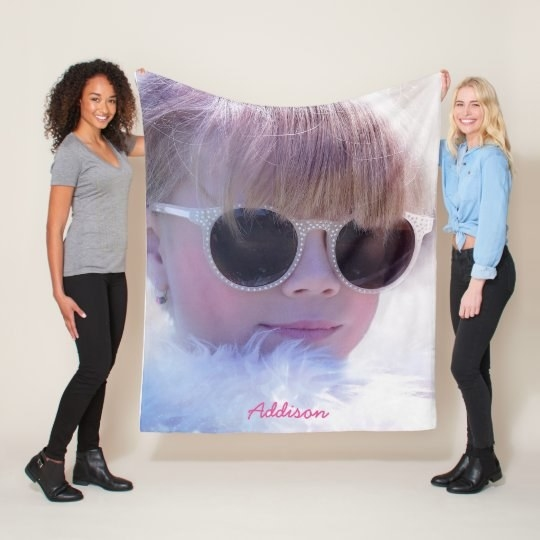Two Models holding up blanket with custom photo and text