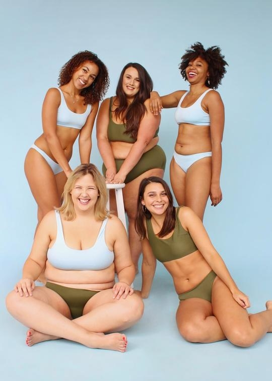 Five models of different sizes and races pose together in their Kitty And Vibe swim wear