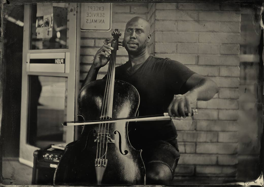 A man plays the cello outside