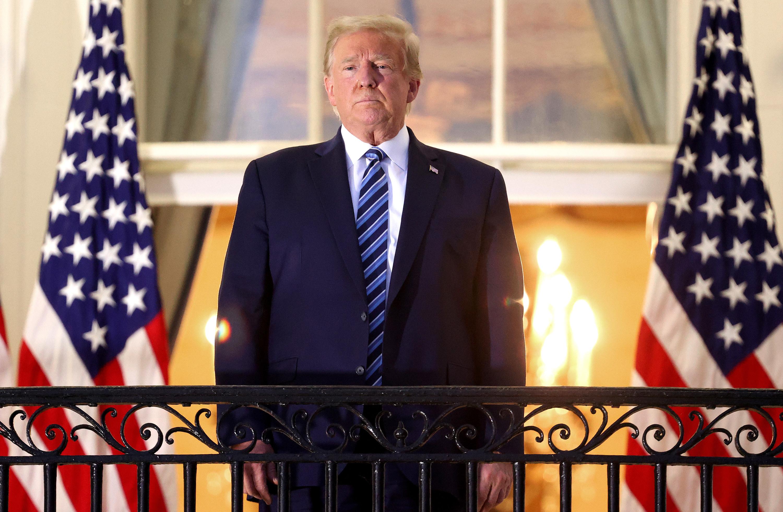Trump on a balcony