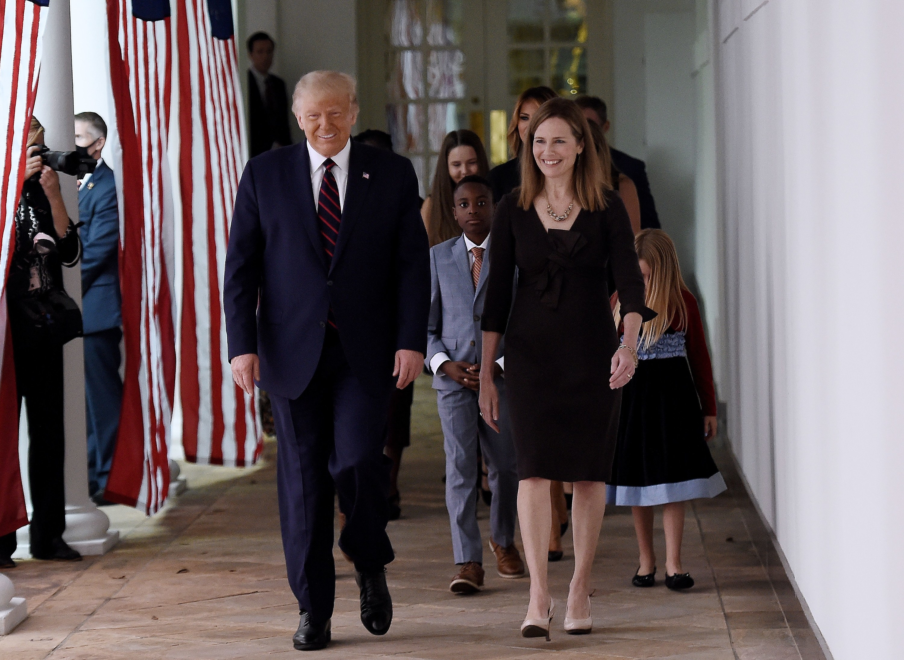 Amy Coney and Trump walking to the rose garden