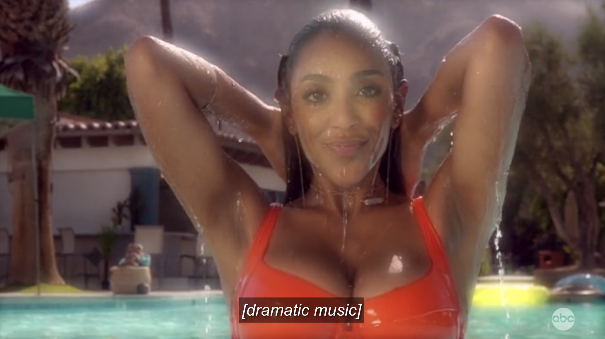 Tayshia gloriously rising out of a pool