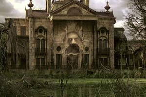 The Haunted Mansion from the Disney movie The haunted mansion with a ghost head emerging from it