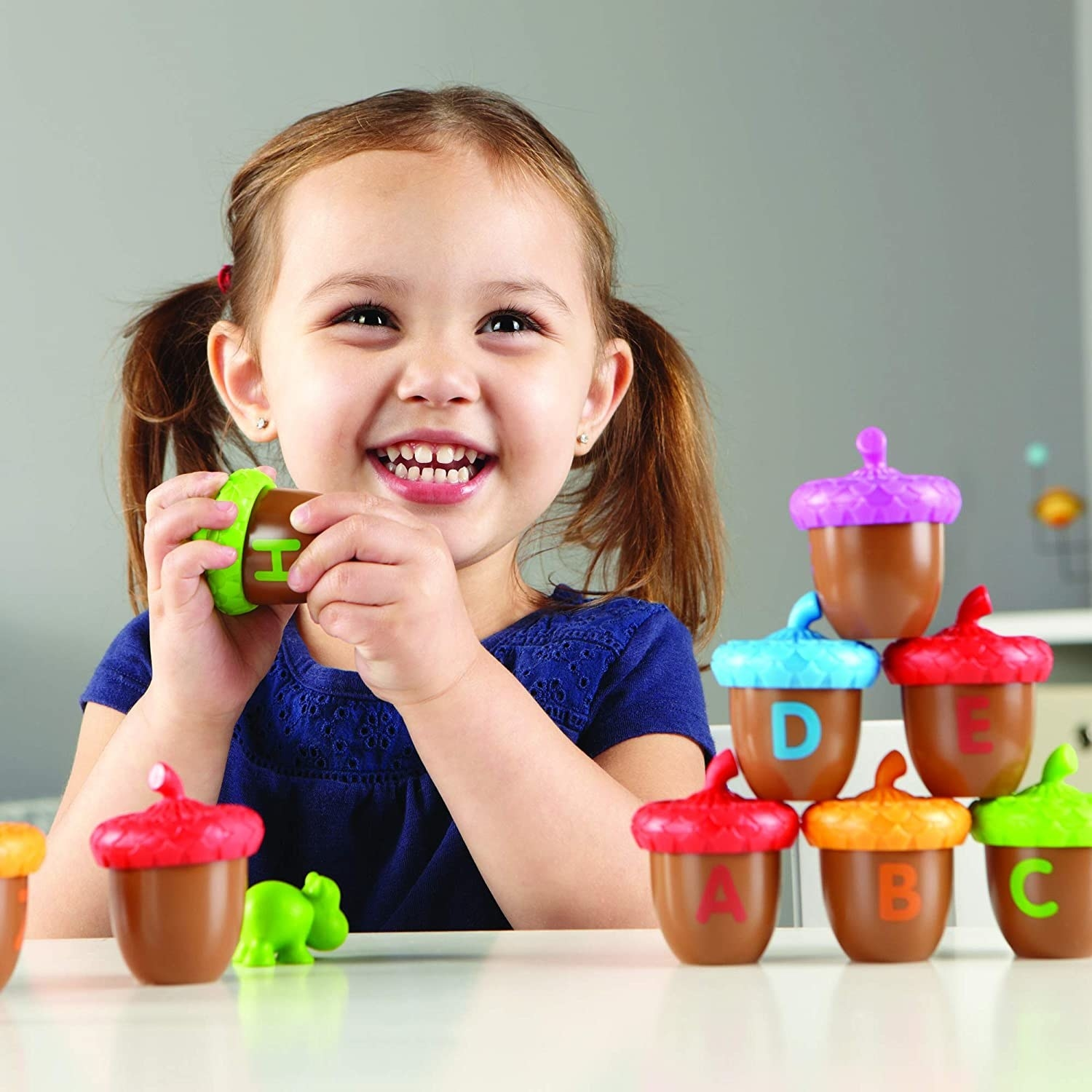 Child model with multi-colored toy acorns