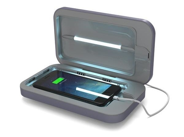 A phone inside of the smartphone sanitizer in periwinkle