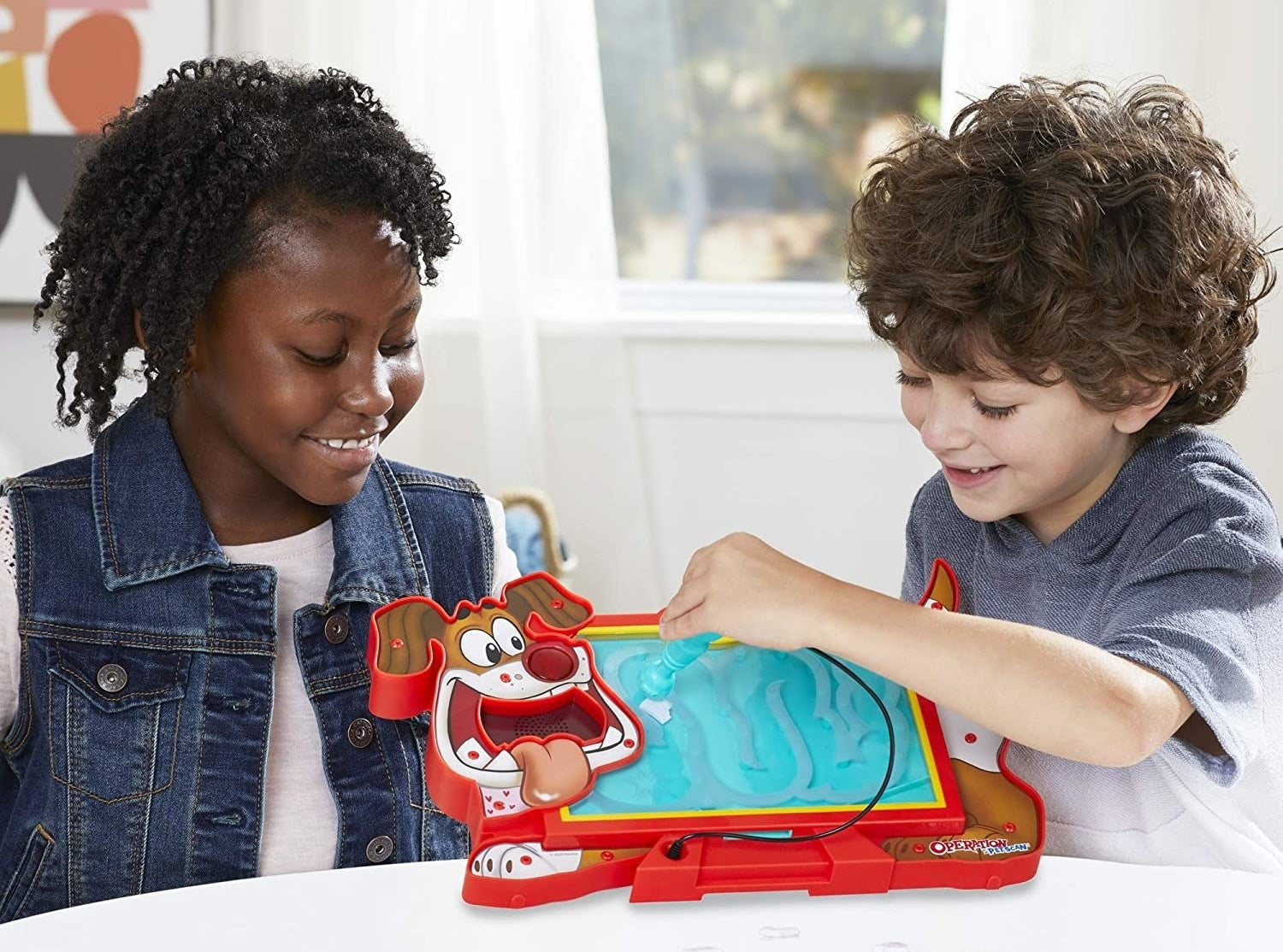 Two child models playing with dog-shaped Operation game