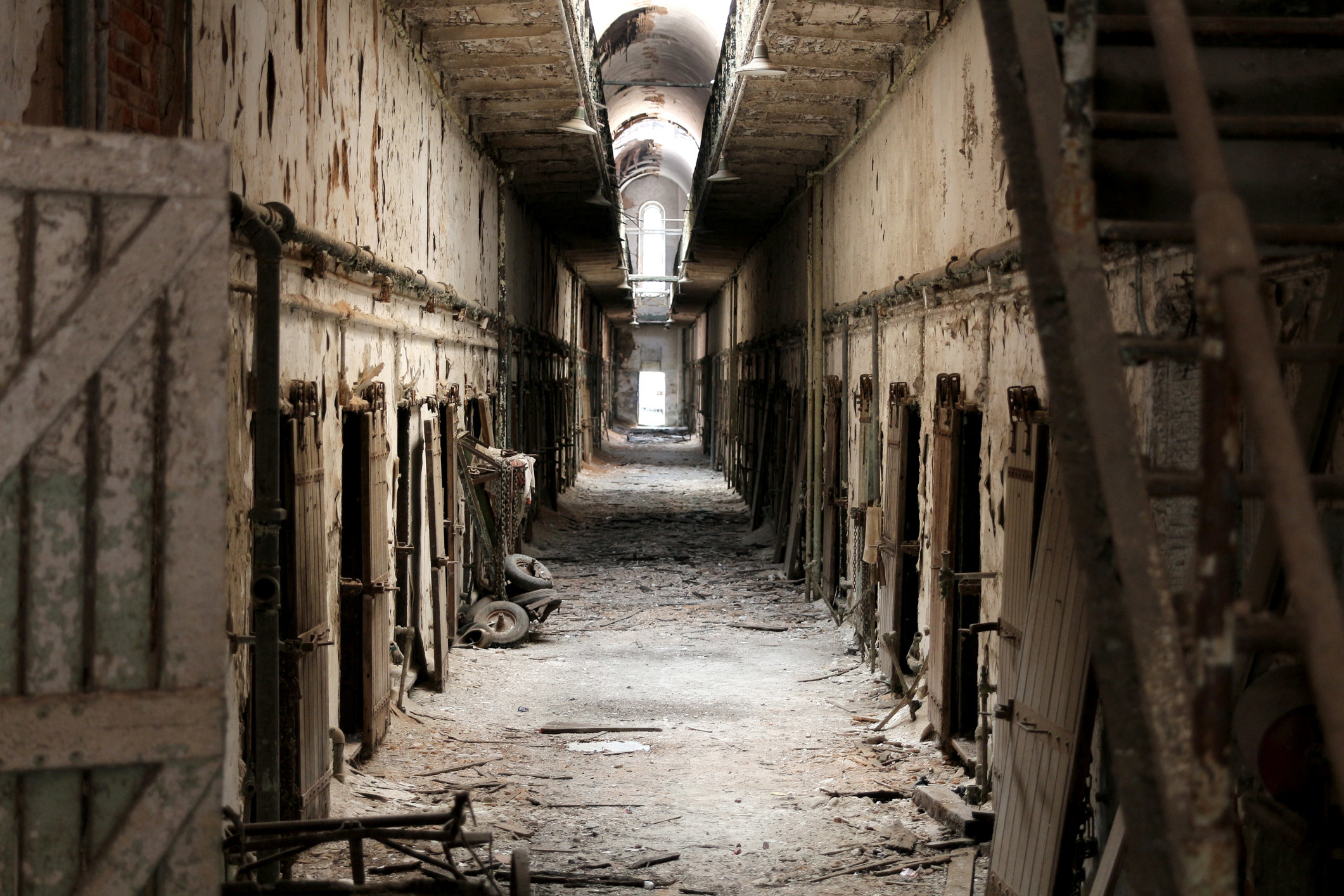 A view down an abandoned cellblock at Eastern State Penitentiary