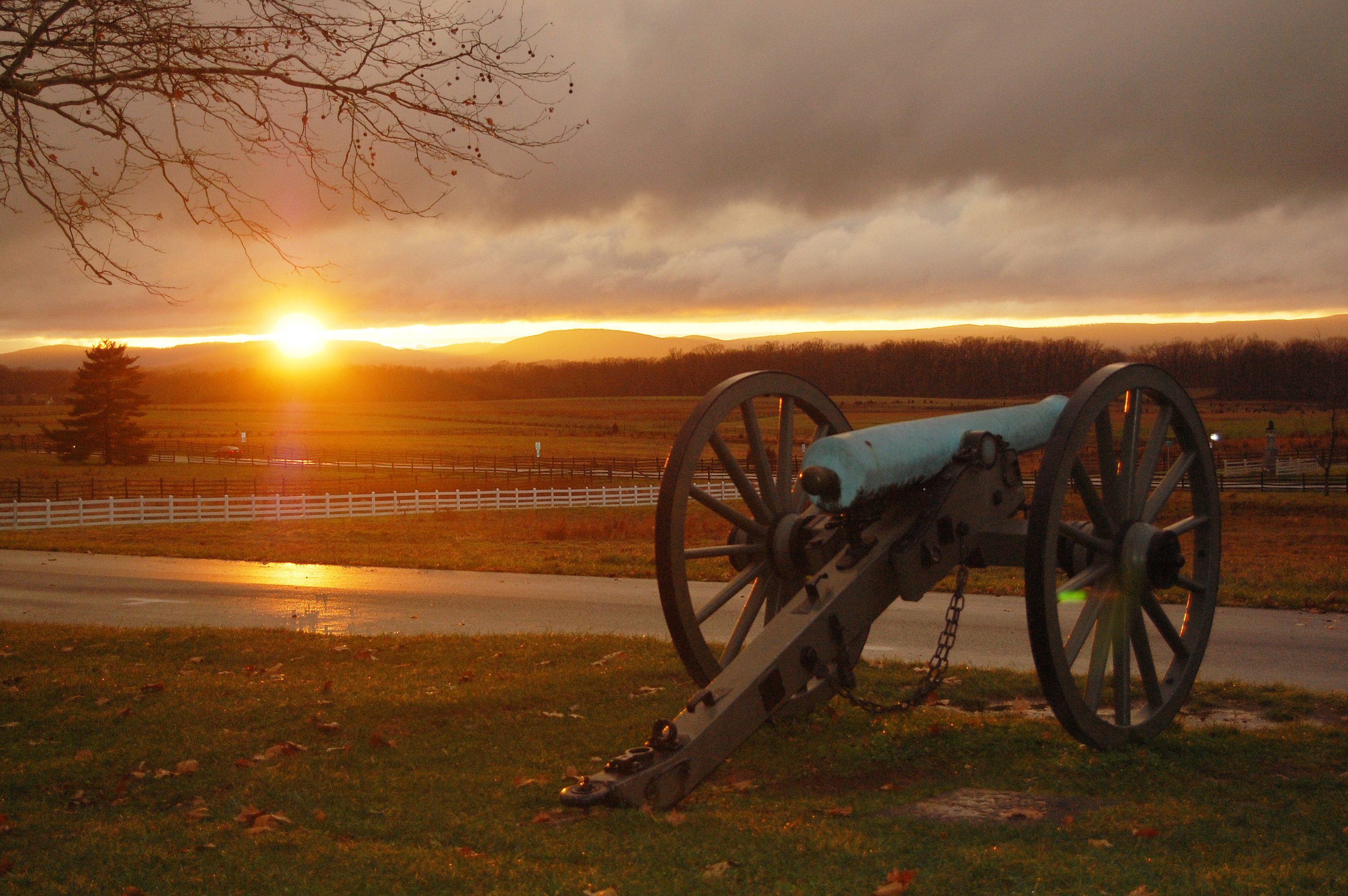 Civil War cannon overlooking the Gettysburg Battlefield at sunset