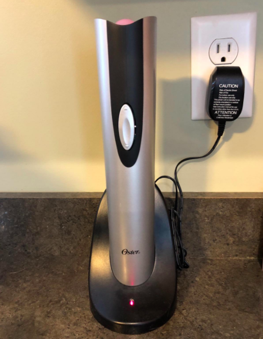 A reviewer photo of the electric wine opener being charged