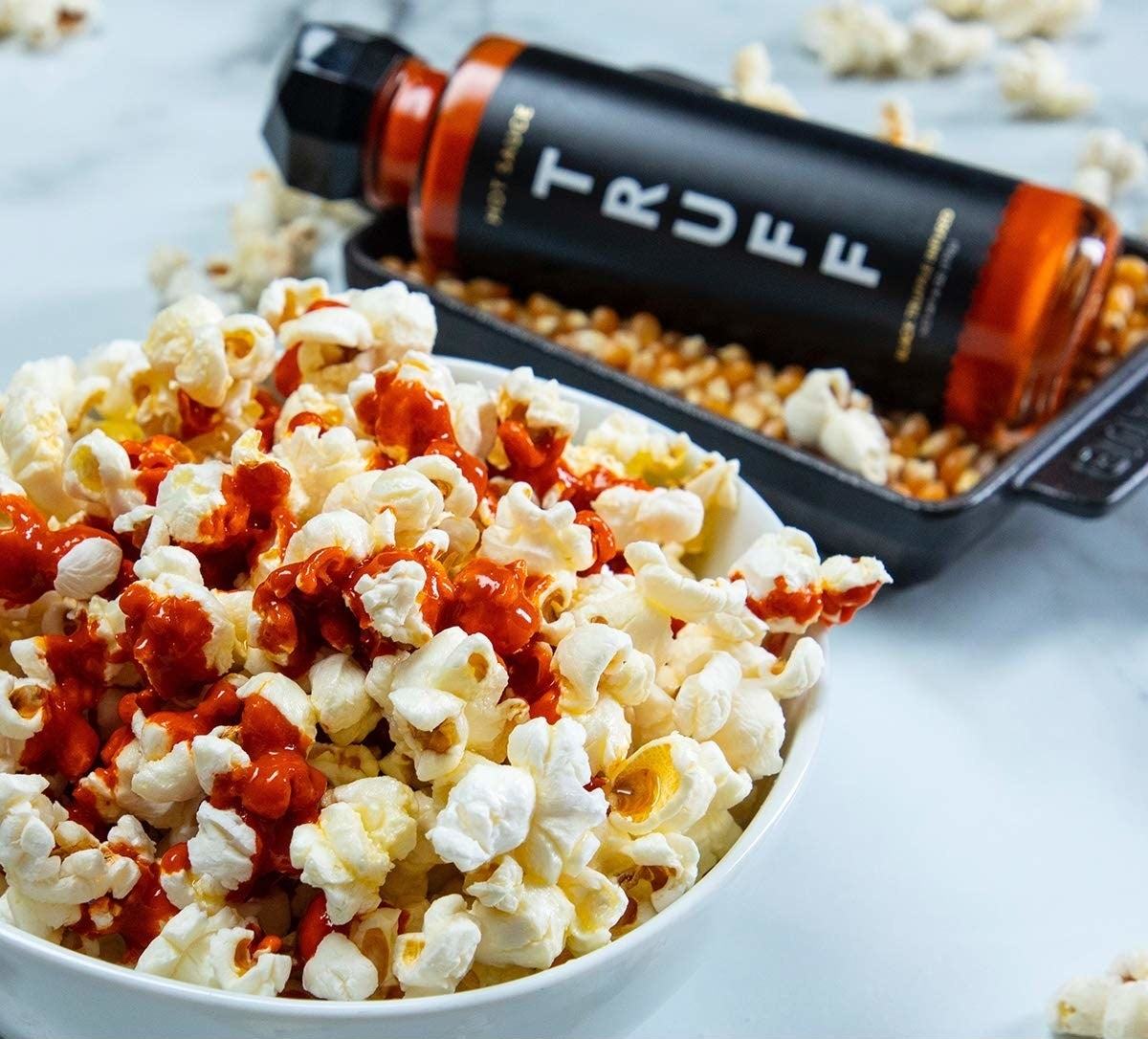 The sauce drizzled on popcorn