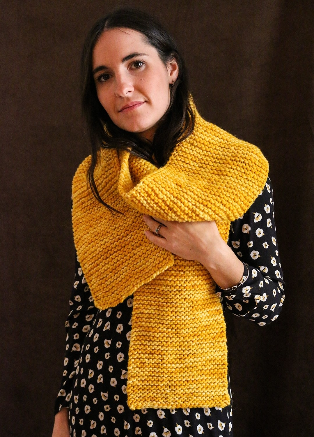 Model wearing the bright yellow scarf