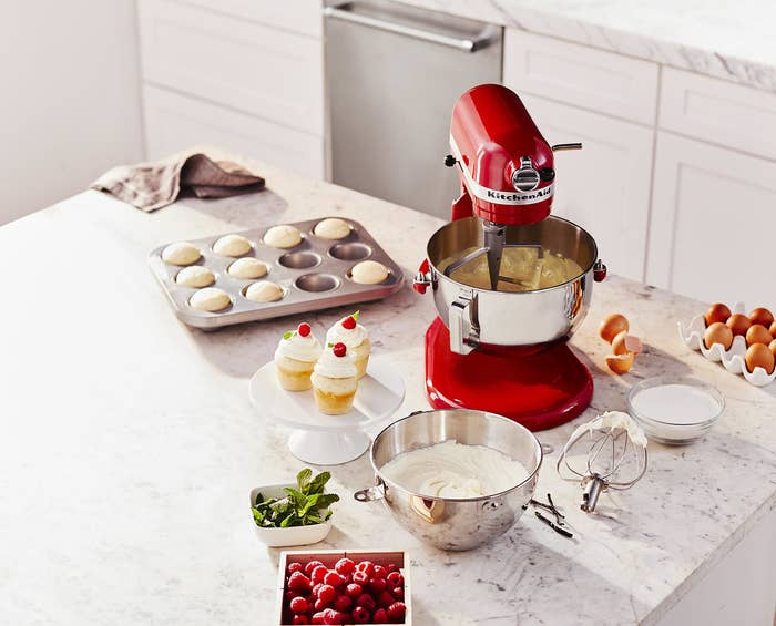 the red kitchenaid mixer and all of the accessories