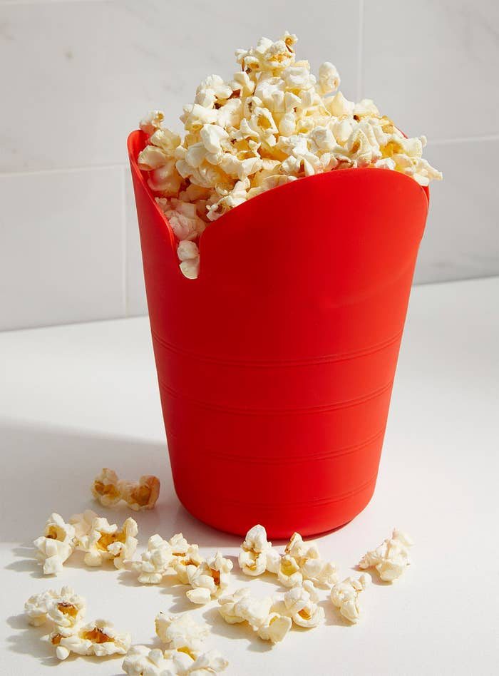 A popcorn container with popcorn in it