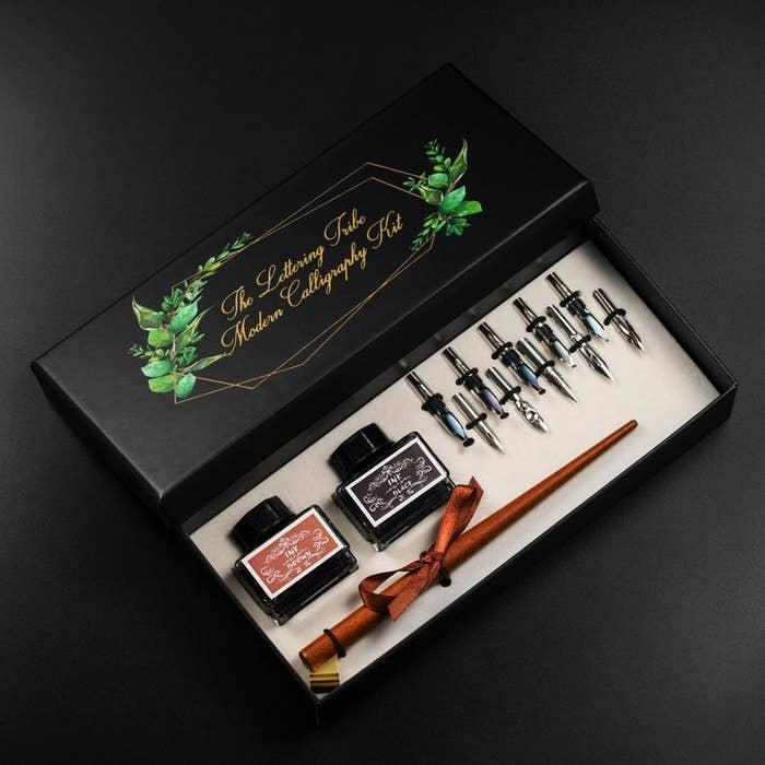 The set with a wooden pen in a pretty box