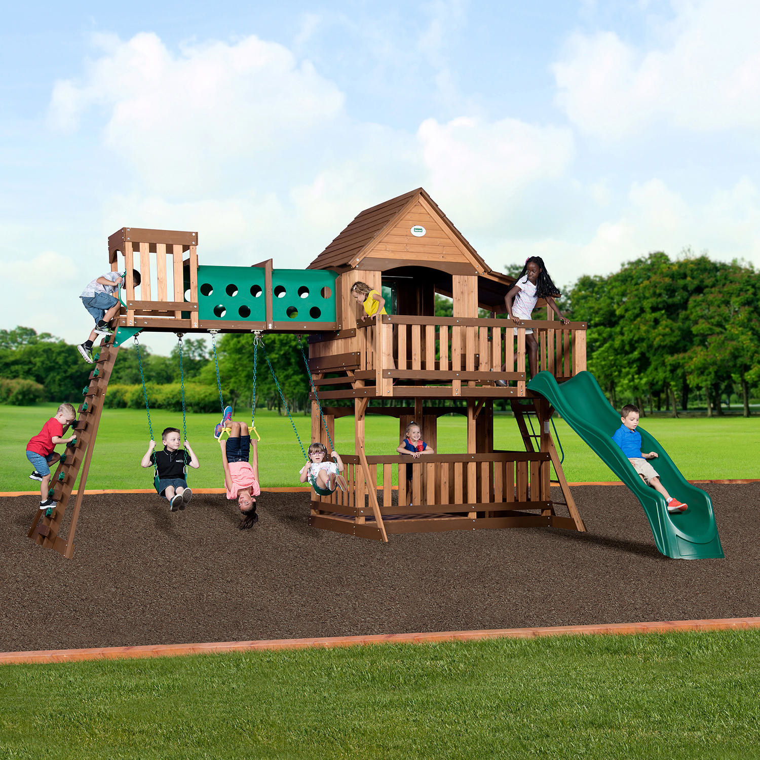 a cedar wood swing set with swings, a rock wall, a tunnel, a slide, and a hide out