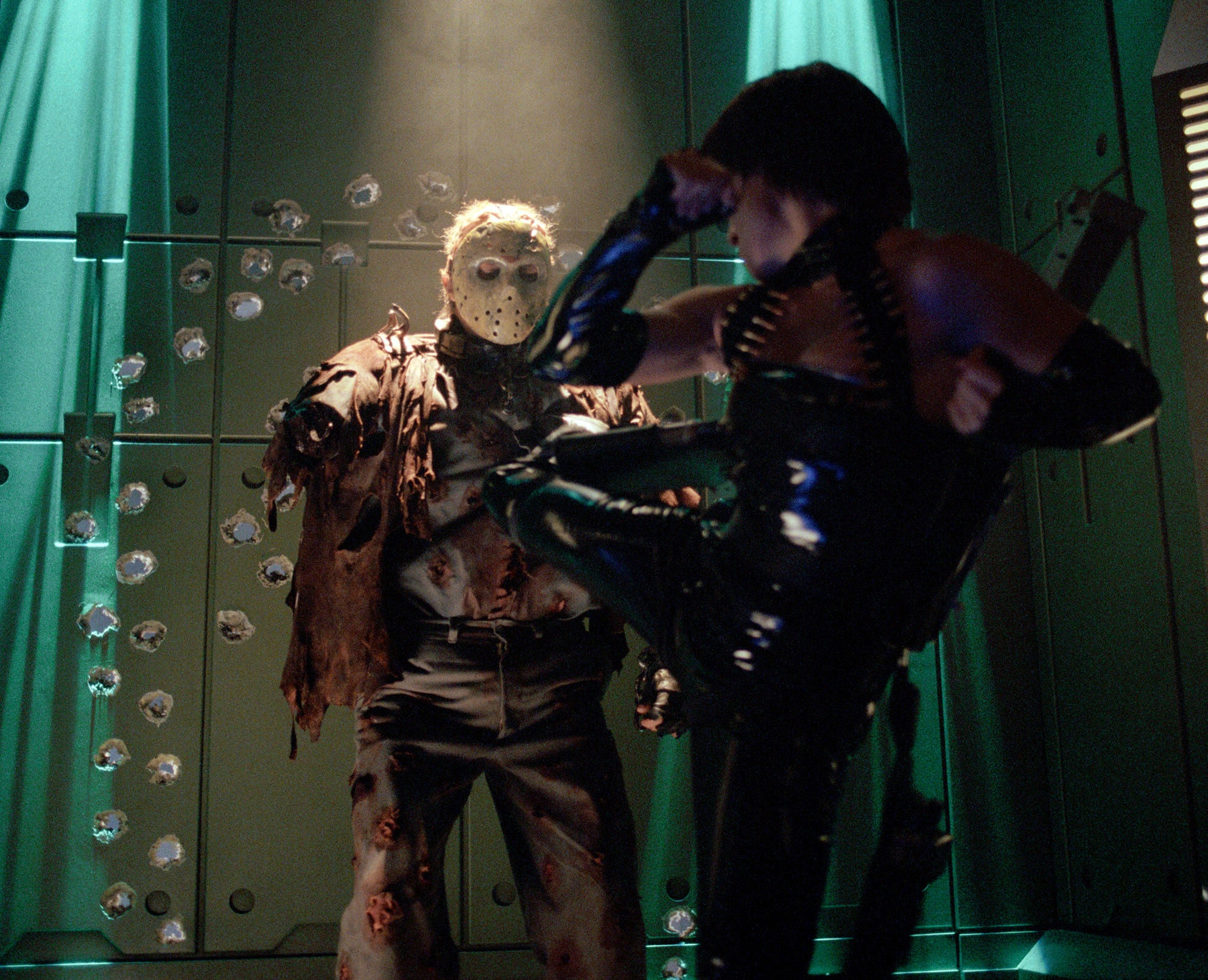 Jason in a spaceship about to be kicked by a female robot
