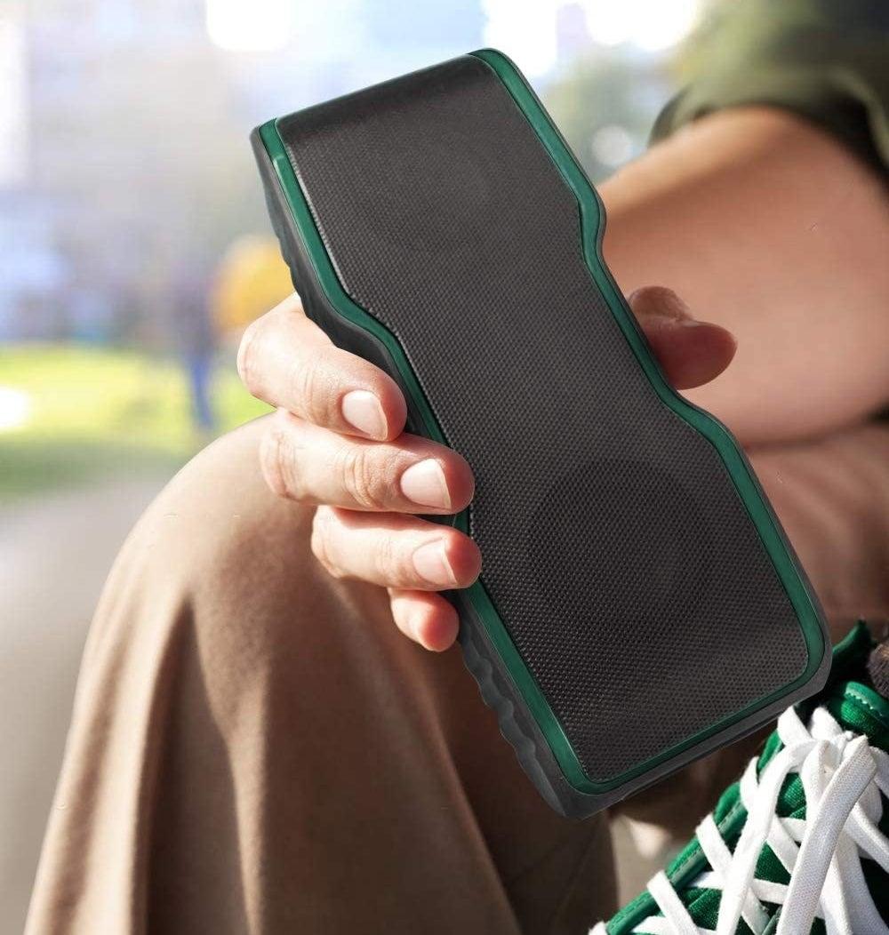 The speaker in green