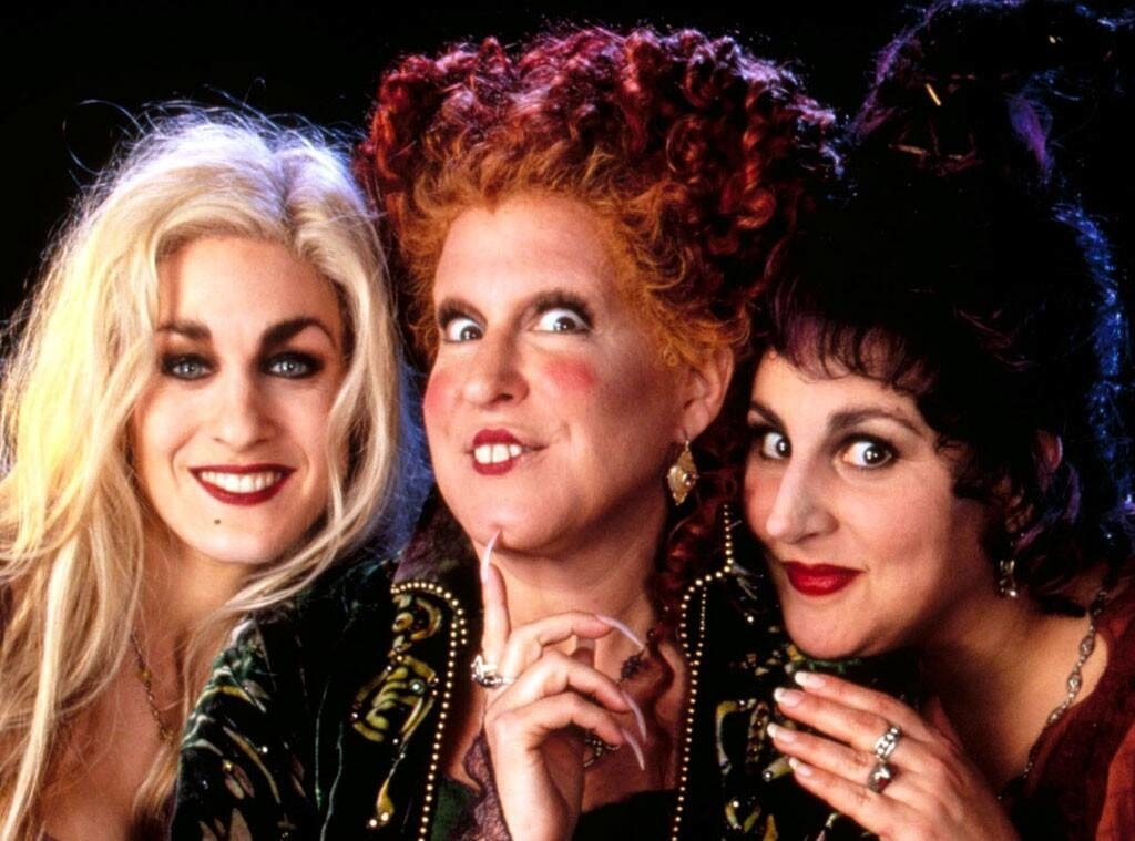 The three main characters from Hocus Pocus smiling at the camera