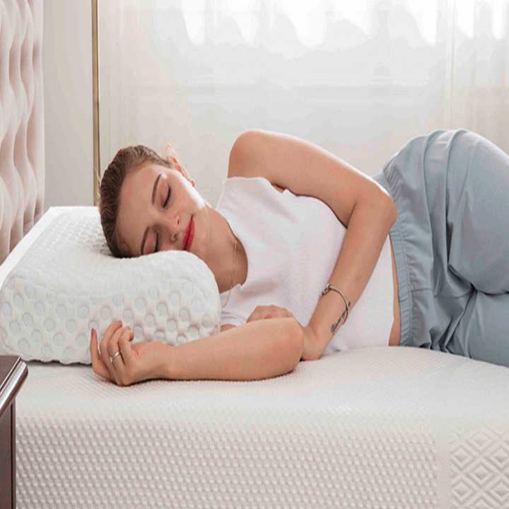 Model sleeping on their side with head on memory foam pillow