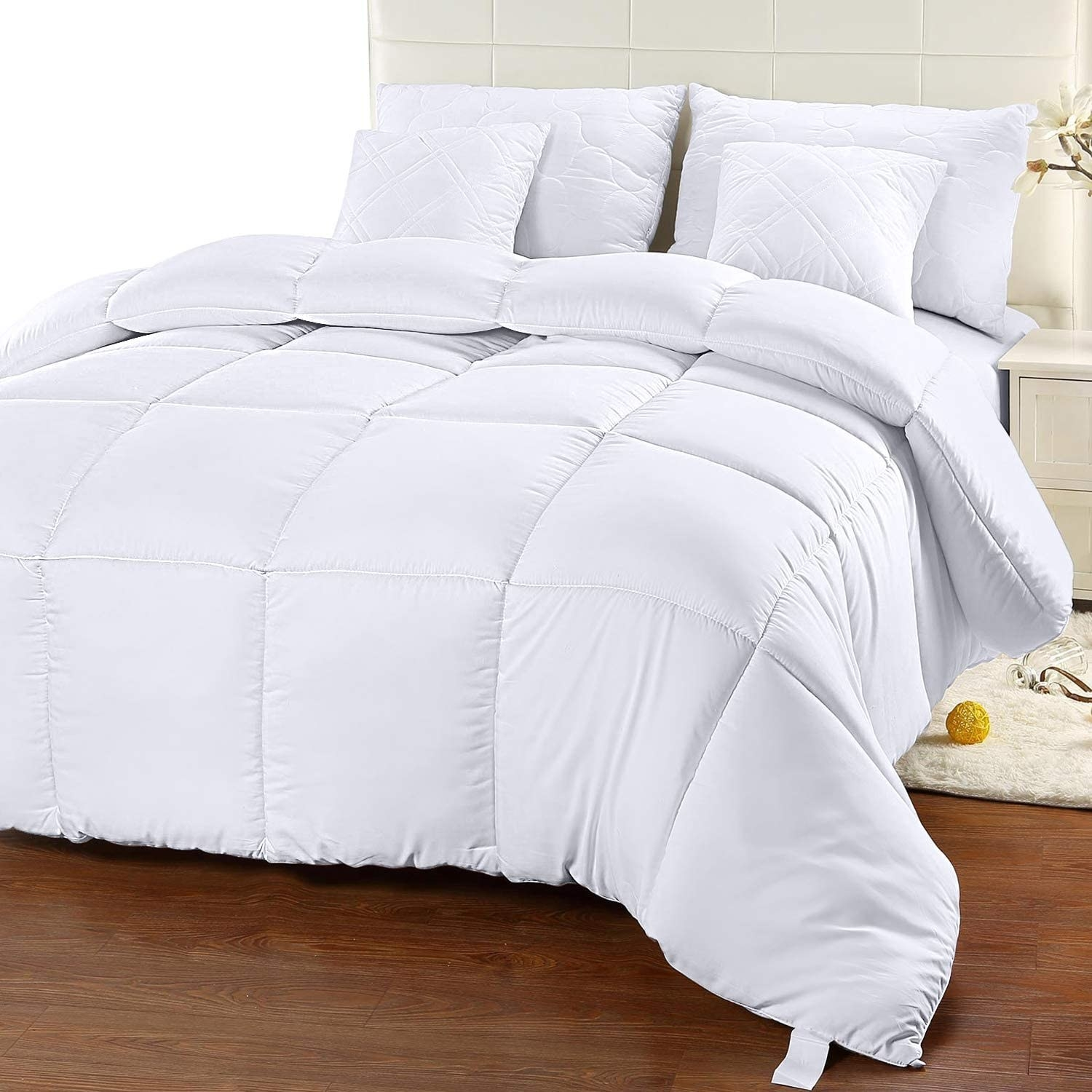 White quilted duvet comforter on a bed