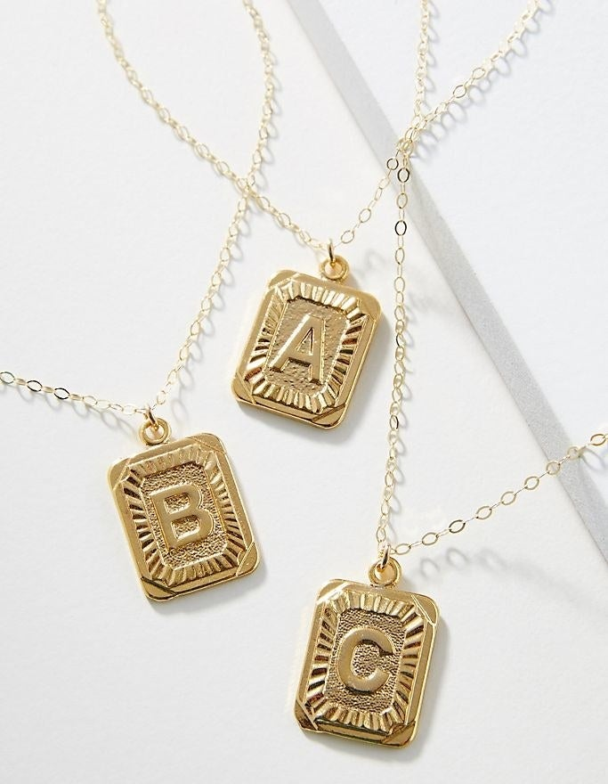 Whim monogram pendant necklaces in letters: A, B and C