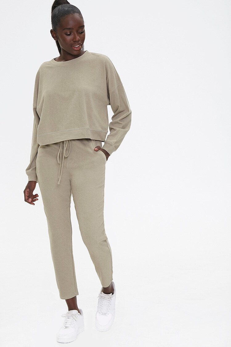 Model wearing the set in green-gray color