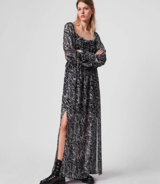 the dress with an animal print and a slit up the leg to about the knee area
