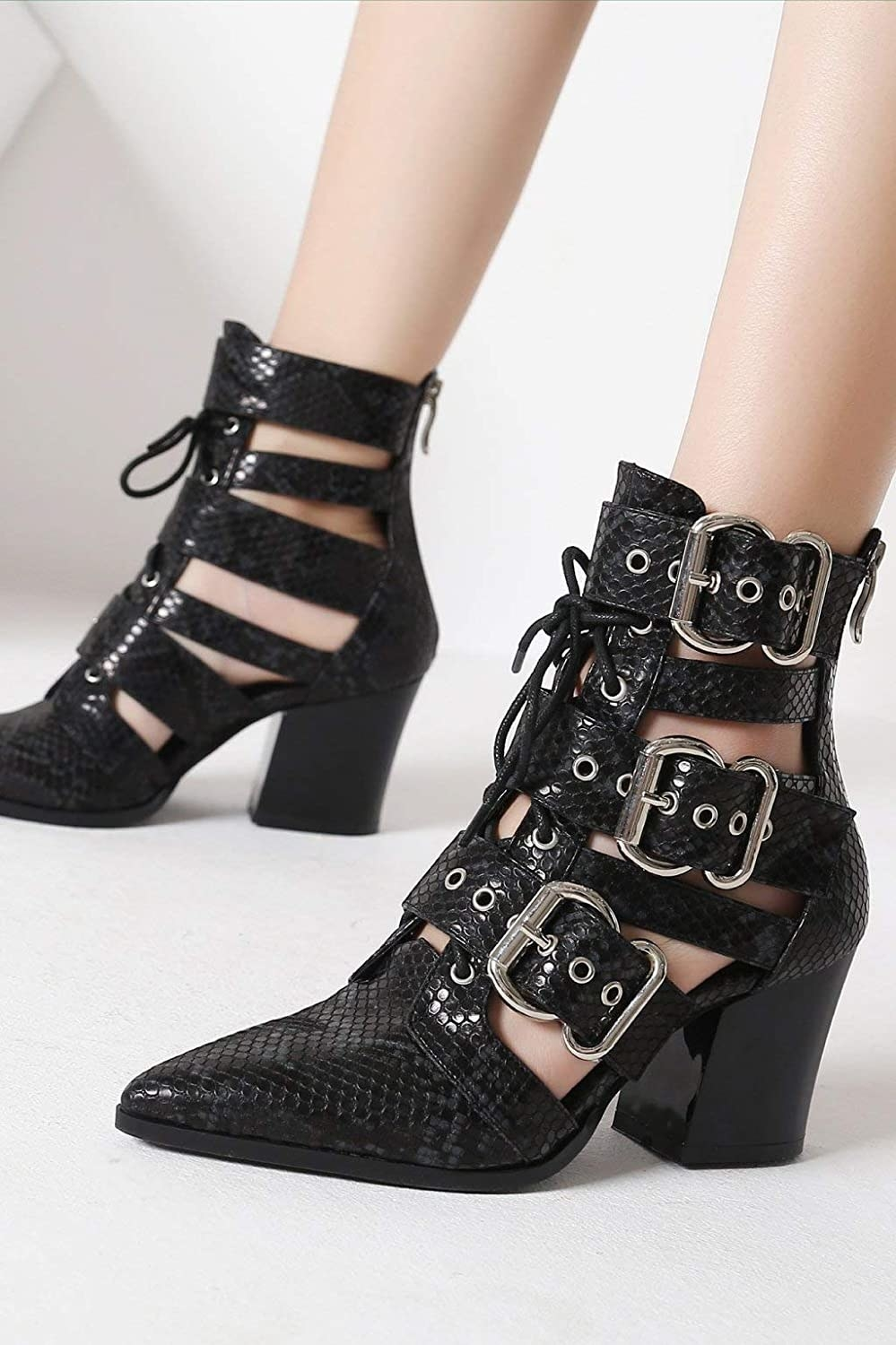 The black lace-up and buckled booties with a chunky heel and silver hardware