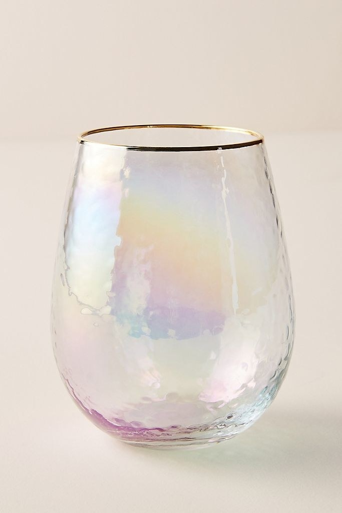 a textured glass with a gold rim and iridescent sheen