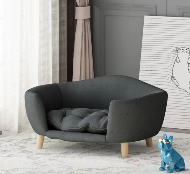 Rounded sofa with tufted cushion and minimalist wooden legs