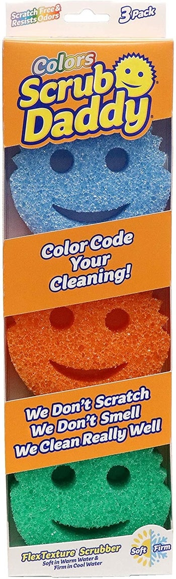 A three-pack of blue, orange, and green Scrub Daddy sponges