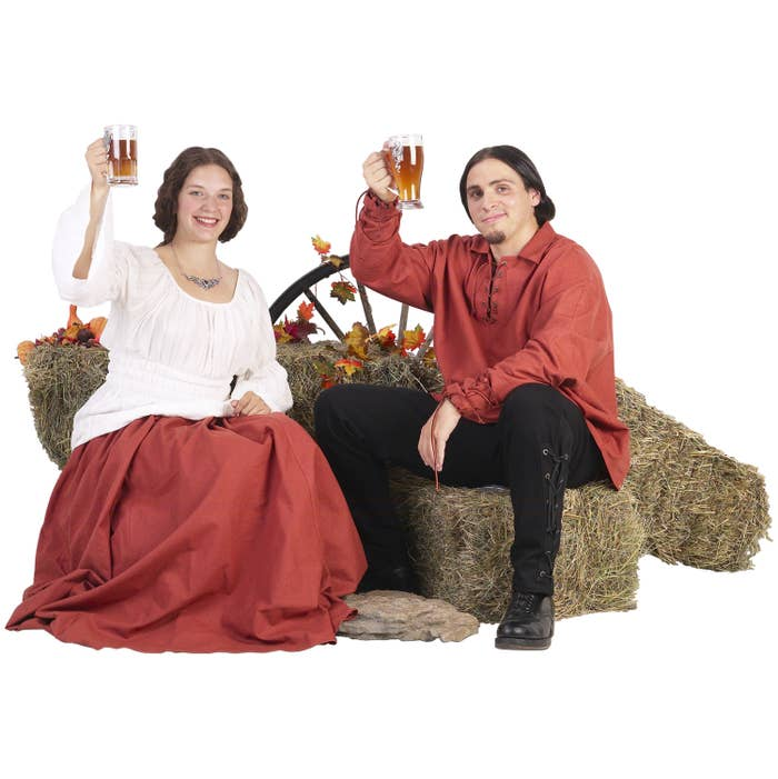 Two peasants toasting with glasses of ale