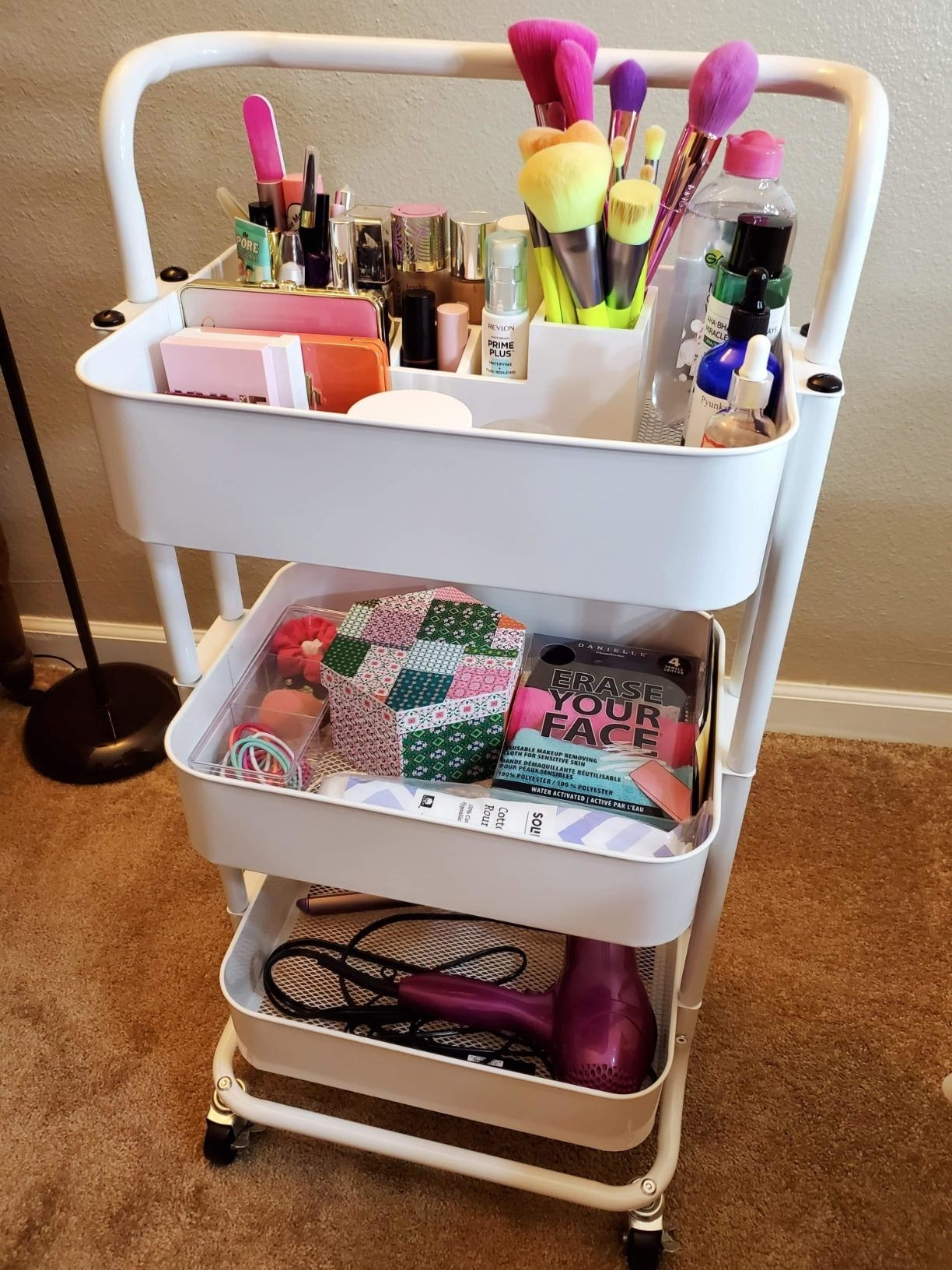 reviewer's white cart filled with beauty products