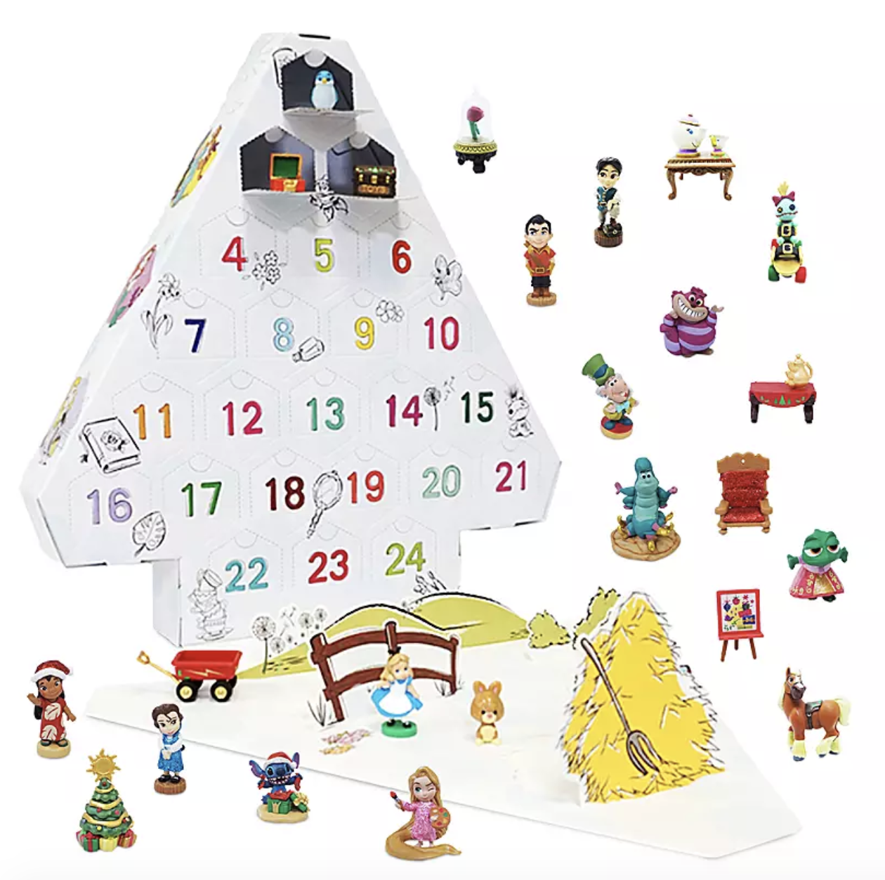 the white tree shaped calendar with 24 slots, surrounded by disney toys