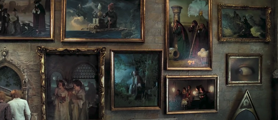 Large portraits hanging in the Hogwarts staircase