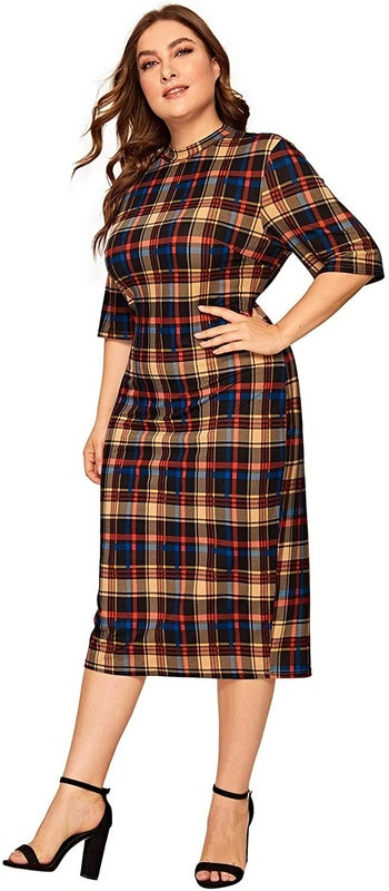A model wearing the dress in blue, brown, and red plaid
